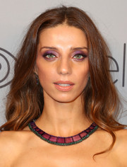 Angela Sarafyan coordinated her eye makeup with a purple and green collar necklace by Maxior.