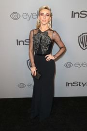Julianne Hough attended the Warner Bros. and InStyle Golden Globes after-party wearing a black Jenny Packham gown with sheer sleeves and a beaded bow accent.