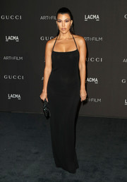 Kourtney Kardashian sizzled in a slinky black halter gown by Gucci at the 2018 LACMA Art + Film Gala.