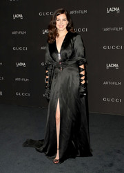 Lana Del Rey styled her dress with black multi-strap sandals.