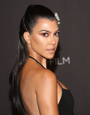 Kourtney Kardashian attended the 2018 LACMA Art + Film Gala wearing her hair in a half-up style.