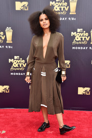 Instead of heels, Zazie Beetz opted for a pair of black patent oxfords.