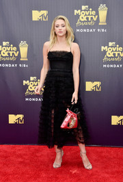 For a pop of color, Lili Reinhart accessorized with a pink satin pouch.
