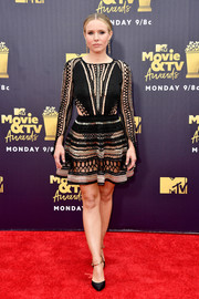 Kristen Bell looked sizzling-hot in a see-through mesh dress by Julien Macdonald at the 2018 MTV Movie & TV Awards.