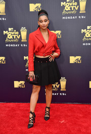 Amandla Stenberg teamed her jacket with a pleated black mini skirt, also by Louis Vuitton.