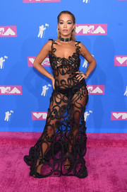 Rita Ora left nothing to the imagination when she wore this sheer, embroidered gown by Jean Paul Gaultier Couture to the 2018 MTV VMAs.