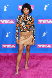 Amandla Stenberg rounded out her look with a pair of nude ankle-strap pumps by Jimmy Choo.