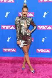 Jasmine Sanders shimmered in a gold keyhole-cutout dress by Dundas at the 2018 MTV VMAs.