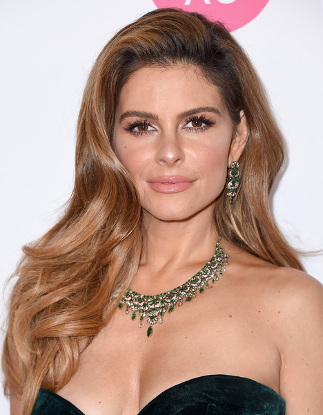 Maria Menounos complemented her strapless green dress with a stunning emerald chandelier necklace.
