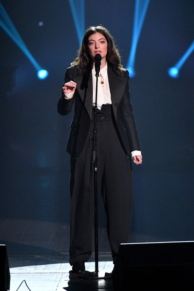 Lorde went menswear-chic in a black pantsuit for her performance at the 2018 MusiCares Person of the Year.
