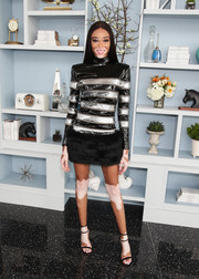Winnie Harlow kept it fun yet fierce in a bold-shouldered patent and fur mini dress by Balmain at the 2018 Roc Nation brunch.