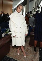 Jasmine Sanders bundled up in an oversized white coat and a matching turtleneck for the 2018 Roc Nation brunch.