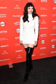 Bella Thorne sealed off her head-turning ensemble with thigh-high PVC boots.