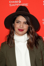 Priyanka Chopra highlighted her pout with some matte red lipstick.
