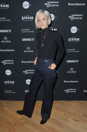 Andrea Riseborough attended the 2018 Sundance Film Festival Cinema Cafe wearing navy Tory Burch trousers and a black turtleneck.