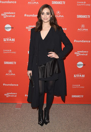 Emmy Rossum arrived for the Sundance premiere of 'A Futile and Stupid Gesture' wearing a black wool coat over a ruffled LBD.