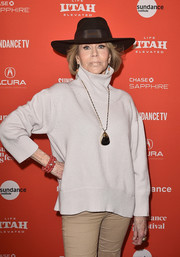 Jane Fonda jazzed up a simple white sweater with an oversized pendant for the Sundance premiere of 'Jane Fonda in Five Acts.'