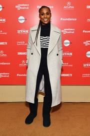 Issa Rae finished off her toasty ensemble with a pair of black sheepskin boat.