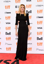 Julia Roberts cut a svelte silhouette in a black Dsquared2 column dress with waist cutouts and pointy shoulders at the TIFF premiere of 'Ben is Back.'