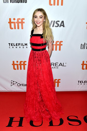 Sabrina Carpenter worked a red Philosophy di Lorenzo Serafini gown with black trim and gold buttons at the TIFF premiere of 'The Hate U Give.'