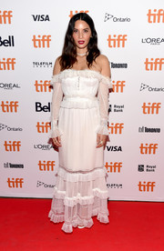 Olivia Munn looked ultra girly in a ruffled white off-the-shoulder gown by Jonathan Simkhai at the TIFF premiere of 'The Predator.'