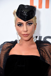 Lady Gaga played up her eyes with heavy sapphire shadow and black liner for the TIFF premiere of 'A Star is Born.'