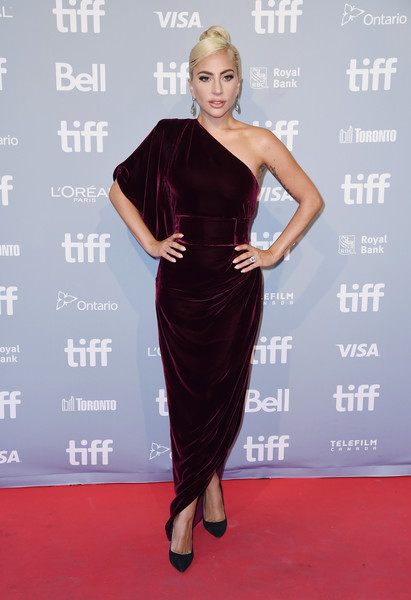 Lady Gaga looked downright elegant in a one-shoulder burgundy velvet gown by Ralph & Russo at the TIFF press conference for 'A Star is Born.'