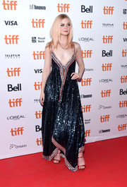 Elle Fanning paired her gorgeous dress with red satin sandals by Giuseppe Zanotti.