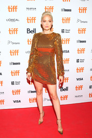 Pom Klementieff sealed off her shimmering ensemble with gold ankle-strap pumps.