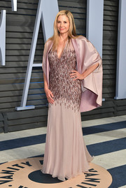 Mira Sorvino attended the 2018 Vanity Fair Oscar party wearing a lilac gown with a beaded midsection.