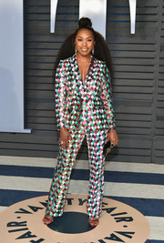 Angela Bassett looked disco-ready in a harlequin-patterned sequin pantsuit by Teresa Helbig at the 2018 Vanity Fair Oscar party.