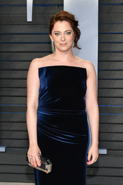 Rachel Bloom paired a faceted gold clutch with a midnight-blue velvet dress for the 2018 Vanity Fair Oscar party.