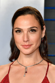 Gal Gadot accessorized with a lovely ruby and diamond pendant necklace by Tiffany & Co.