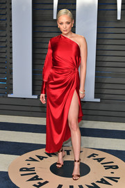 Pom Klementieff was modern and chic in a red one-sleeve dress by Monse at the 2018 Vanity Fair Oscar party.