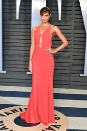 Taylor Hill looked captivating in a coral cutout gown by Narciso Rodriguez at the 2018 Vanity Fair Oscar party.