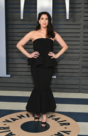 Sarah Silverman was girly and chic in a strapless black peplum dress by Christian Siriano at the 2018 Vanity Fair Oscar party.