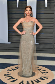 Sarah Hyland got glammed up in an Ermanno Scervino metallic strapless gown with a tulle overlay for the 2018 Vanity Fair Oscar party.