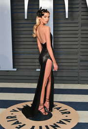 Stella Maxwell amped up the sex appeal with a pair of black multi-strap sandals by Rene Caovilla.
