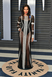 Padma Lakshmi made eyes pop with this sheer black-and-white fishnet and lace gown at the 2018 Vanity Fair Oscar party.