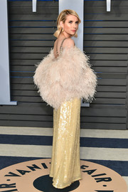 Emma Roberts got glammed up with a pale pink feather stole for the 2018 Vanity Fair Oscar party.