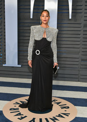 Tracee Ellis Ross went full-on glam at the 2018 Vanity Fair Oscar party in a Balmain 44 François Premier cutout gown boasting a crytal-studded bodice and a ruched, metal ring-embellished waist.