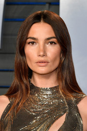 Lily Aldridge attended the 2018 Vanity Fair Oscar party wearing a hippie hairstyle.