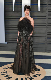 Paz Vega slipped into a black Elie Saab Couture halter gown with an ostrich-feather bodice and a semi-sheer, metallic-embroidered skirt for the 2018 Vanity Fair Oscar party.