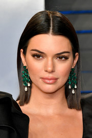 Kendall Jenner's Lorraine Schwartz emerald chandelier earrings popped glamorously against her black outfit.