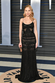 Halston Sage was goth-chic in a black J. Mendel slip gown with a metallic print and sheer lace inserts at the 2018 Vanity Fair Oscar party.