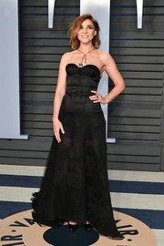 Clotilde Courau looked sultry in a strapless black corset gown at the 2018 Vanity Fair Oscar party.