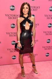 Bethenny Frankel complemented her LBD with PVC sandals by Gianvito Rossi.