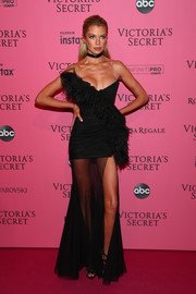 Stella Maxwell dolled up in a feather-adorned strapless gown by Ester Abner for the 2018 Victoria's Secret after-party.