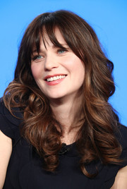 Zooey Deschanel paired choppy bangs with curly ends for the 2018 Winter TCA Tour.