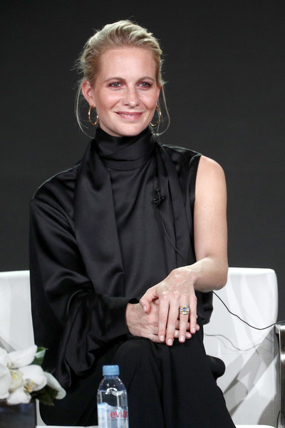 Poppy Delevingne looked sophisticated in a black silk blouse with a high neck and a single sleeve at the 2018 Winter TCA Tour.